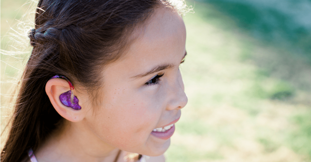 Community spotlight: Callie's hearing aid helps her hear like a superhero