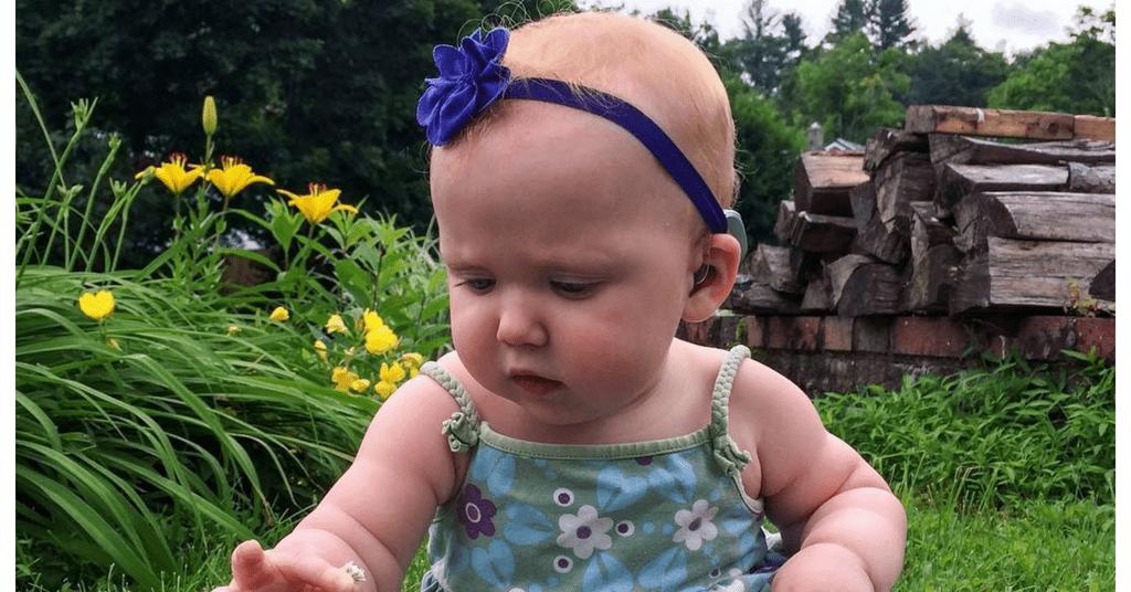 child wearing hearing aids