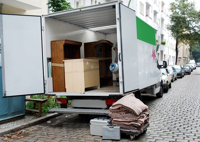 house move van with furniture and tools