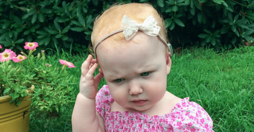 Tips for keeping a baby's hearing aids in their ears